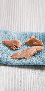 Three flakes of salmon on towel