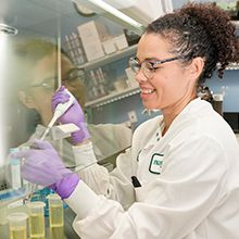 Female scientist examining ingredients in a laboratory